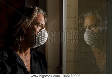 Coronavirus Male Medical Mask Quarantine, Self Isolation Concept, Reflection Of Middle Aged Man In W