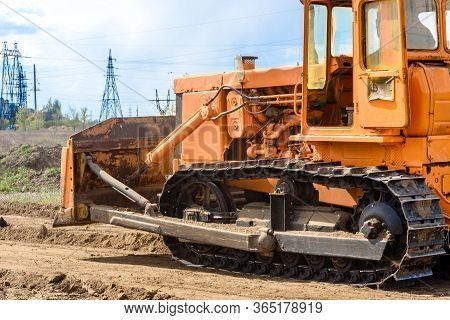 Industrial Building Construction Site Bulldozer Leveling And Moving Soil During Highway Building. Ye