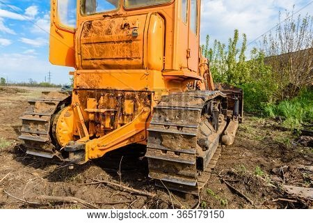 Industrial Building Construction Site Bulldozer Leveling And Moving Soil During Highway Building