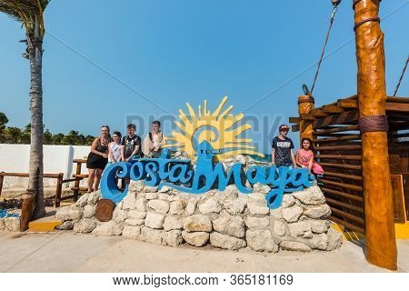 Costa Maya, Mexico - April 26, 2019: Street View At Day With Tourists Near Costa Maya Sign In Costa
