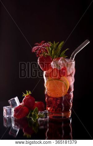Strawberry Mojito Cocktail At The Bar. Mojito Cocktail Over Black Background. Cocktail Mojito In The