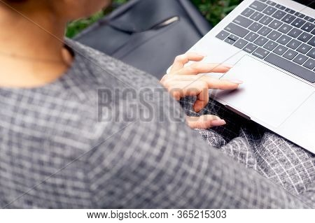 Close Up Of Woman Finger And Hand Is Using Touchpad Of Laptop Computer. Female Hand Uses A Touchpad