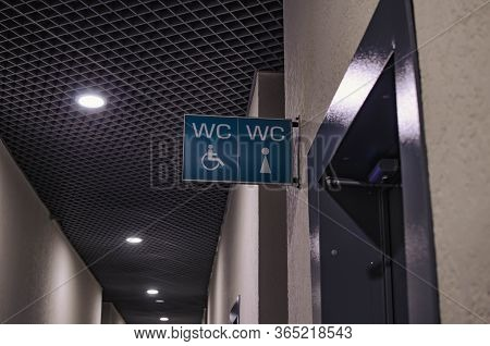 Sign About The Toilet For Men And Women In The Shopping Center