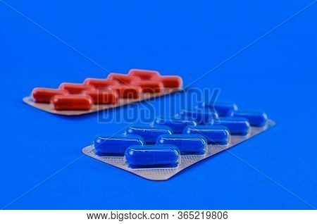 Two Packs With Blue And Red Tablets.