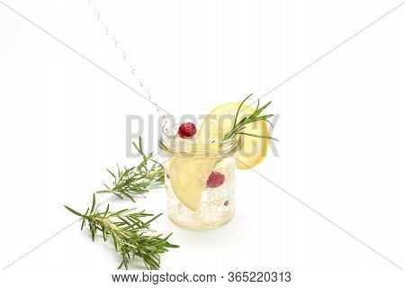 Refreshing Tonic Drink With Ice, Lemon And Fresh Fruit. Refreshing Drink Concept
