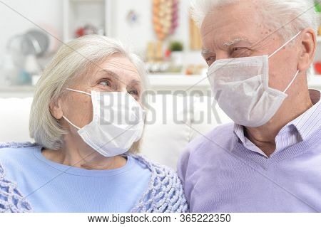 Sick Elderly Woman And Man With Facial Masks