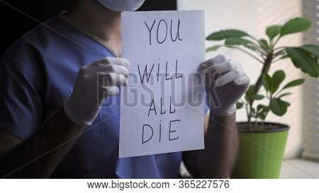 Male Doctor Shows Bad Prediction About Death Holding Paper Blank With An Inscription That Everyone W