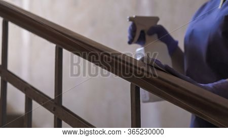 Railing Disinfection. Close Up Hands Of Medical Worker In Rubber Gloves Handling Liquid Disinfectant