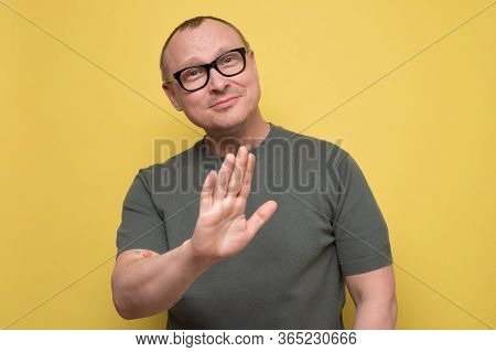 Attractive Man In Glasses Shows Refusal Gesture, Telling Leave Me In Piece.