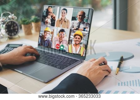 Group Of Creative Construction Engineer Using Laptop For Video Conference Meeting And Discussion Abo