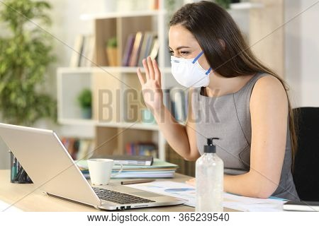 Happy Entrepreneur Woman Greets To Laptop Webcam On Videocall On Coronavirus Confinement At Homeoffi