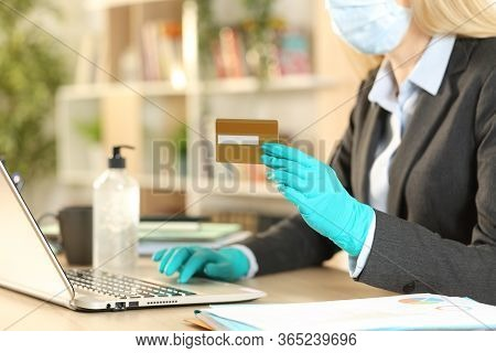 Close Up Of Entrepreneur Woman Paying Online With Credit Card On Laptop Avoiding Coronavirus With Ma