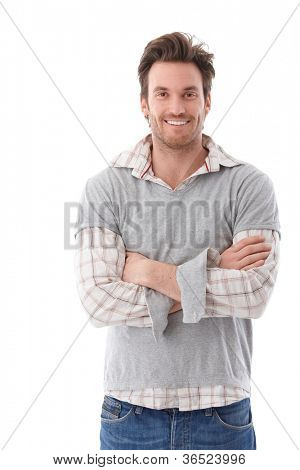 Confident young man looking at camera arms crossed, smiling.
