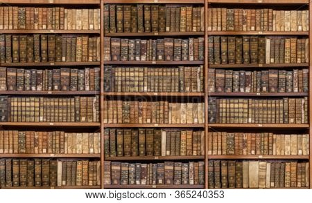 Defocused And Blurred Image Of Old Antique Library Books On Shelves For Use In Video Conferencing Ba