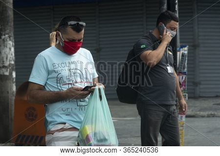 Rio, Brazil - May 06, 2020: People On The Street Wearing A Mask To Protect Themselves From The Coron