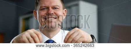 Man Business Clothes Sitting At Table And Smiling. Happy Man Working At Home In Self-isolation. Impl
