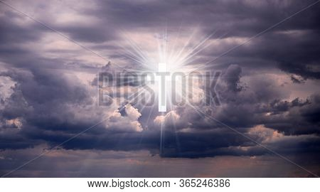 Religious Background With Holy Cross Glowing. Christian Cross In A Sky With Some Clouds. Cross Cruci