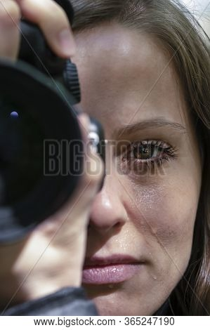 A Female Reporter Weeps While Filming The Tragedy. A Look At The Camera And Tears On The Face Of A B