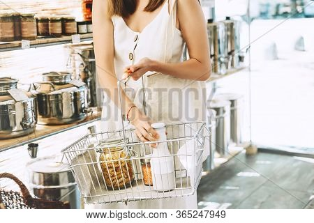 Shopping At Local Small Business. Woman With Grocery Products In Reusable Glass Jars Inside Metal Ba