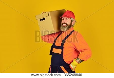 How Home Should Feel. Think Outside The Box. Express Delivery Concept. Man Worker In Boilersuit Hold