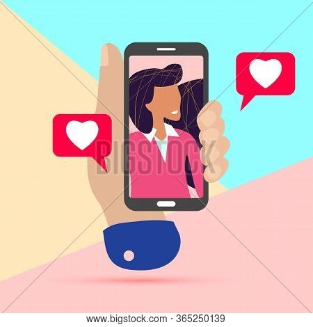 Online Dating Concept. Male Hand Holding Smart Phone With Girlfriend On Screen During Video Call And