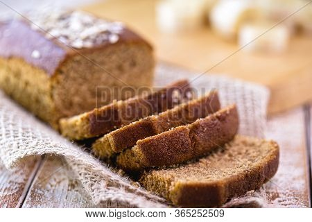 Gluten-free Vegan Bread And No Animal Products. Vegetarian Bread With Oatmeal, Banana Flavor, On A W