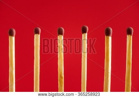 Line With Wooden Matchsticks Isolated On Red