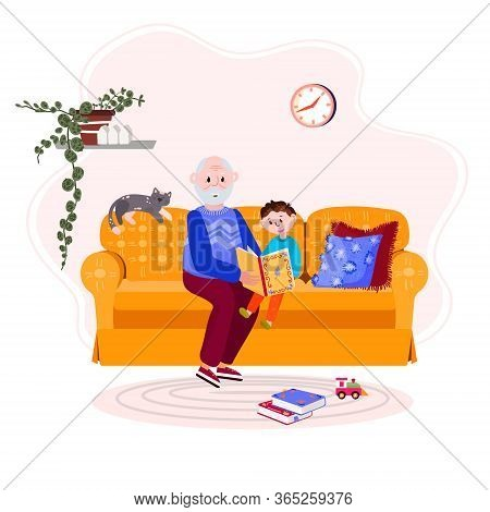 Grandfather Is Reading Book Grandson. Old Man With Boy Is Sitting On Cozy Sofa And Read Story. Happy