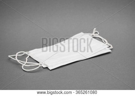 Several Medical Masks Are Isolated On A Grey Background. Medicine And Healthcare. Protection Against