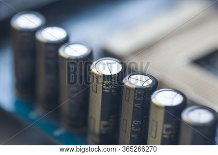Fragment Of The Motherboard With Electrolytic Capacitors. Capacitive Assembly. Electronic Component