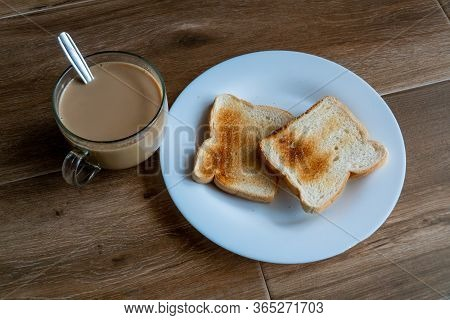 Cup Of Coffe With Milk And Two Slices Of Toasted Sandwich Bread On A White Plate. Healthy Breakfast