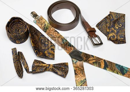 Accessories, Belt, Bow Tie, Suspenders, Tie And Scarf. Shot From Above, On A White Background.