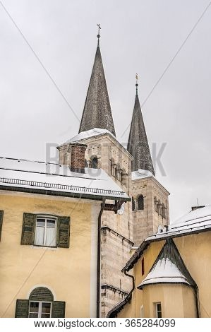 Steeple Of Stiftskirche St. Peter Und Johannes Der Taufer In Berchtesgaden, Germany With Snow