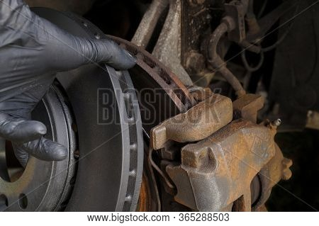 Comparison Of Worn And New Brake Disc. Brake Replacement.