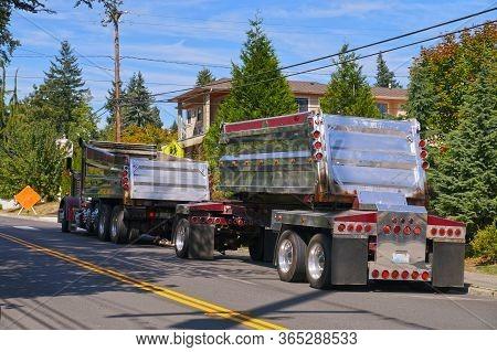 Large Chrome Truck Awaiting Asphalt Unloading. Street Renovation In The City.