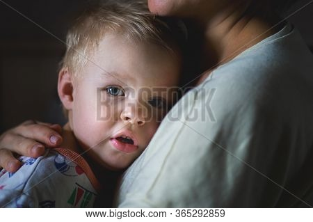 A Tearful Little Boy Clings To His Mother To Calm Down. A Mothers Care And Custody. The Relationship