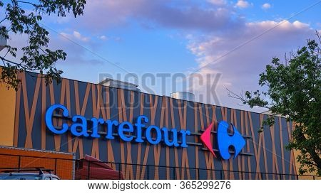 Carrefour Market Logo On The Exterior Of Parklake Shopping Mall Building In Bucharest, Romania - Apr