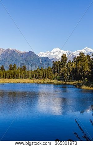 Matheson Lake - Mirror Lake. Mount Cook And Mount Tasman Portrait. Southern Alps. South Island. New