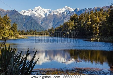 Landscapes Of New Zealand. Matheson Lake. Southern Alps. South Island