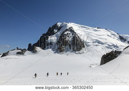 Group Of Alpinists Climb Mont-blanc Du Tacul, View From Aiguille Du Midi In The French Alps, Chamoni