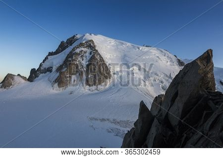 Mont-blanc Du Tacul With A Big Rock View From The Cosmiques Hut In The French Alps, Chamonix-mont-bl