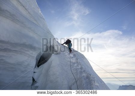 Alpinist Climbs Mont-blanc Du Tacul ( Three Mounts Route, Par Les 3 Monts) In The French Alps, Chamo