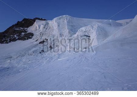Big Snow Pack With Glacier Crevasse On Mont-blanc Du Tacul In The French Alps, Chamonix-mont-blanc,