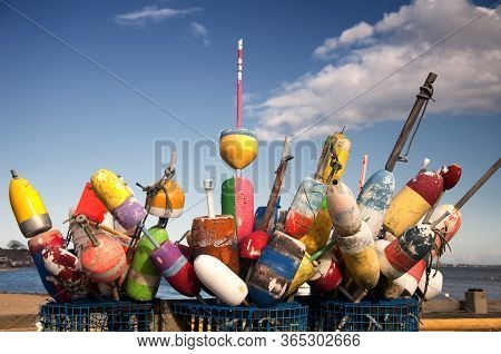Baskets Of Colorful Fishing And Lobster Buoys On A Wharf In Provincetown, Massachusetts On A Sunny C