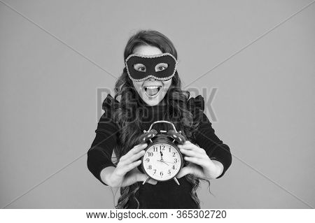 Right Time Is Now. Party Girl Show Clock Time. Small Child In Carnival Mask Hold Alarm Clock. 12 Ocl