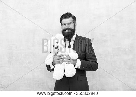 Huggably Soft And Ideal For Cuddling. Happy Businessman Hold Teddy Bear Toy Blue Background. Bearded