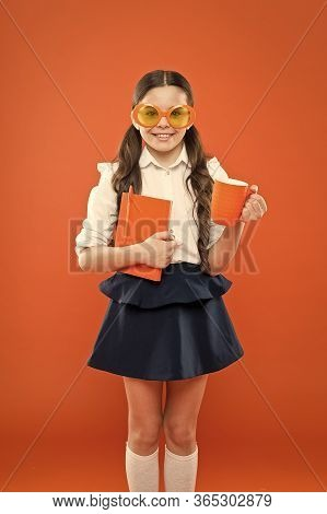 Lunch Time. Happy School Girl In Uniform And Party Glasses. Small Child With Notebook. Reading Educa
