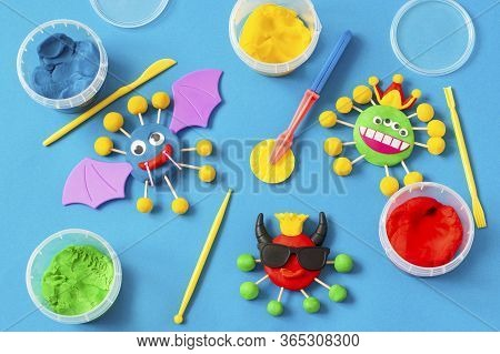 Child Makes Scary Coronaviruses From Modeling Dough. Modeling From Clay Or Dough, Children's Craft D