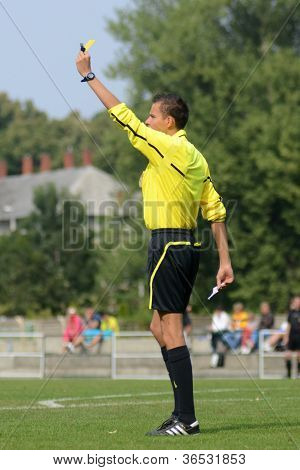 KAPOSVAR, HUNGARY - SEPTEMBER 1: Attila Csatlos (referee)  in action at the Hungarian National Championship under 15 game  Kaposvar(white) vs. Szekszard (black) September 1, 2012 in Kaposvar, Hungary.