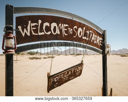 Welcome Sign And Rusty Old Vehicle In Solitaire. Solitaire Is A Small Settlement In The Khomas Regio